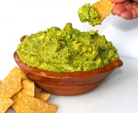 How to open an avocado and prepare the easiest Game Day Guacamole Dip for your party.